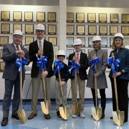 Hampton Roads Academy Headmaster Peter W. Mertz, Campaign Chair Wendy Drucker '76, Board of Trustees Chair Alison V. Lennarz and student leaders from each division donned hard hats and wielded shovels in a symbolic gesture commemorating the start of construction for the new facility.